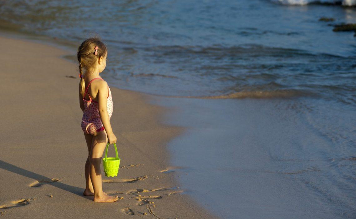 girl-on-beach-green-house-oleksandr-pidvalnyi-pexels